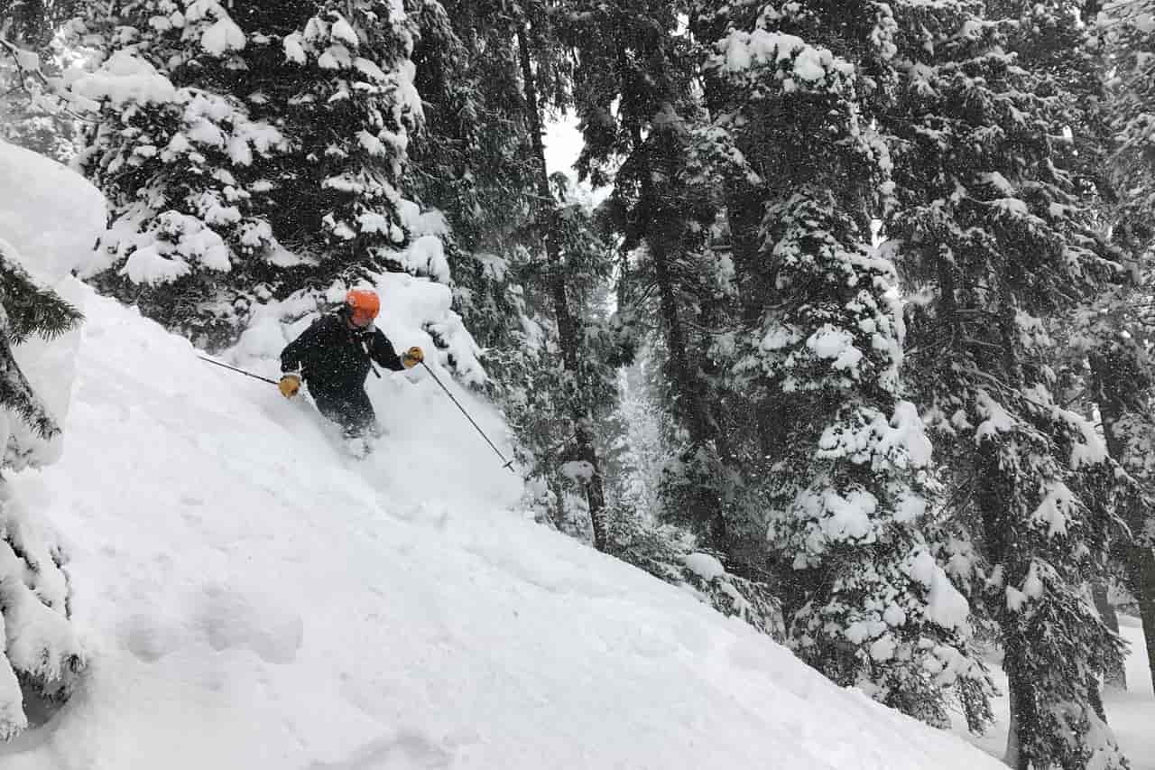 A man skiing on powdery snow