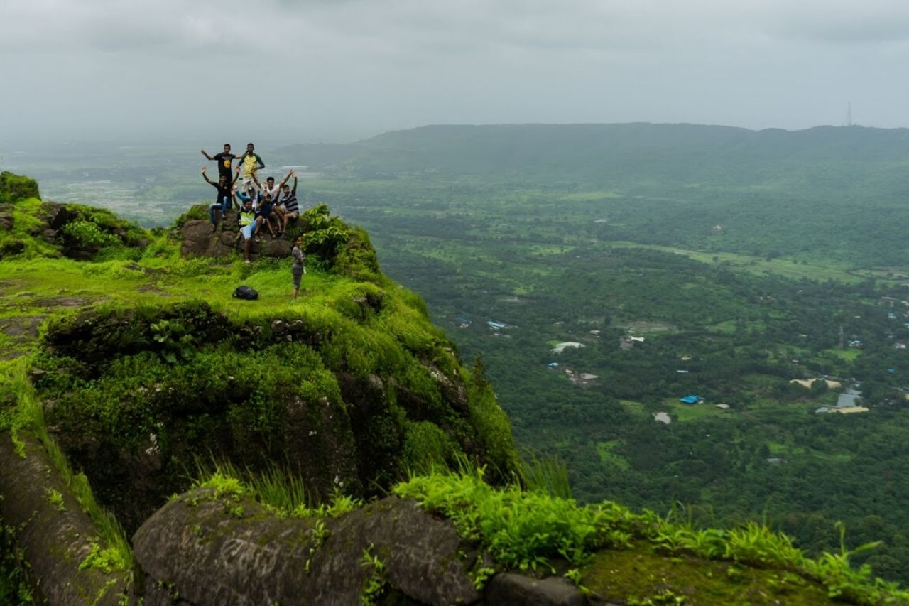 People standing on the ramparts of ancient fort