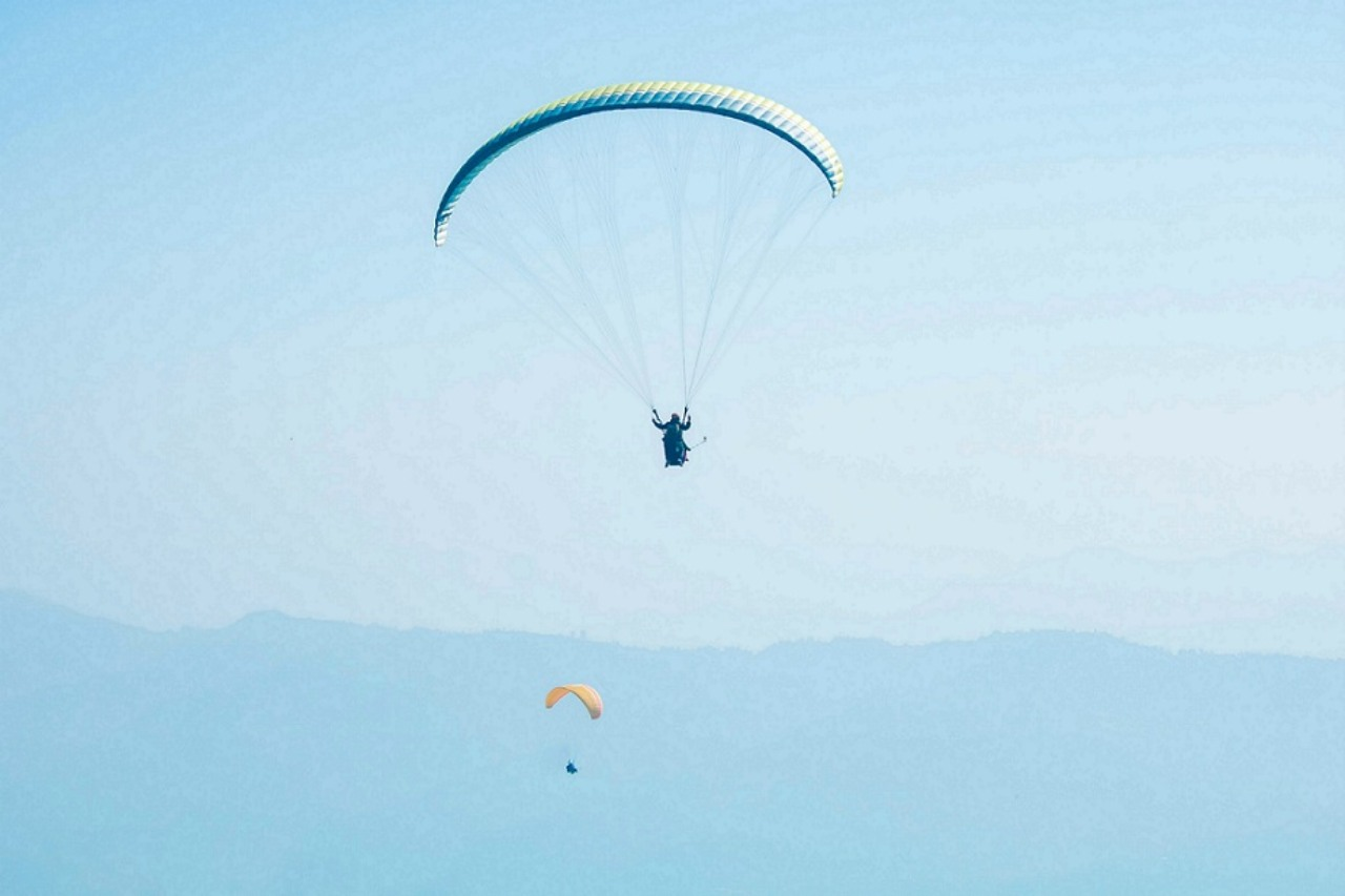 Three paragliders in the air.