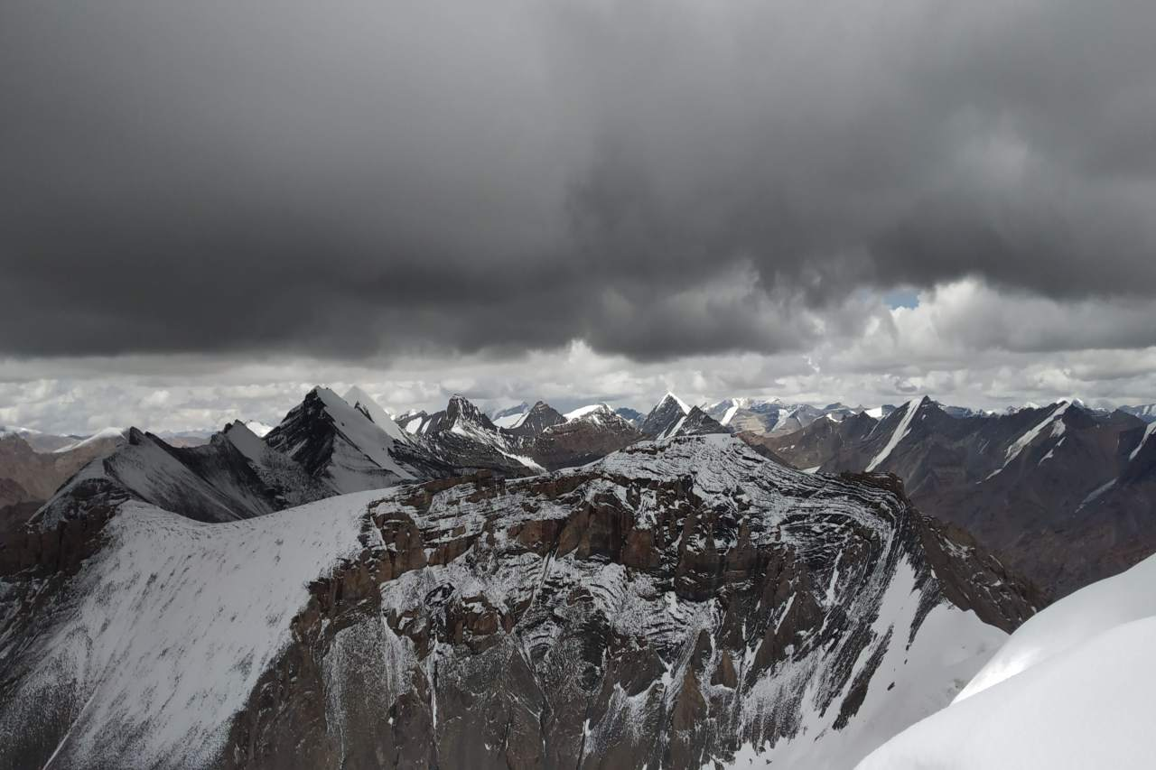 A view from a summit of unending snowy peaks