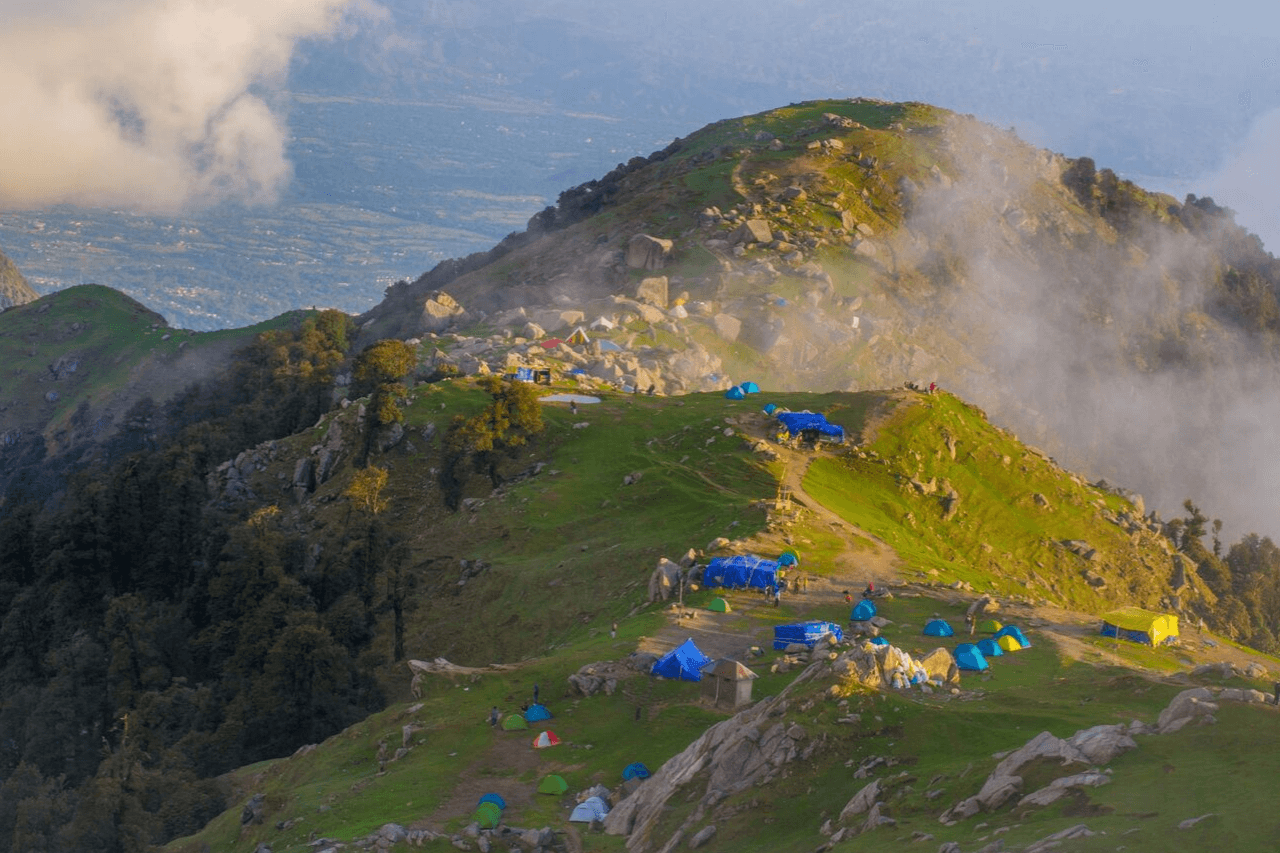 The evening sun illuminates the campsite at Triund top.