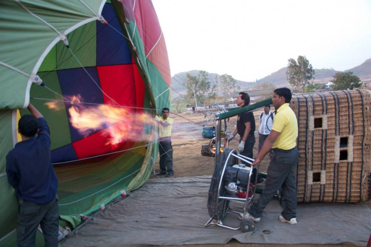 A crew filling up a hot air balloon with gas