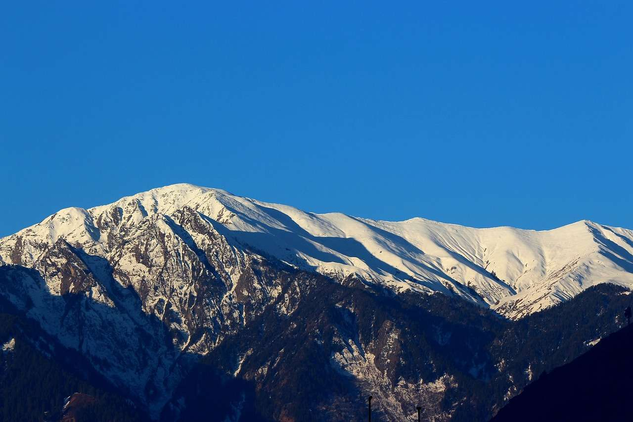 A snow covered mountain peak