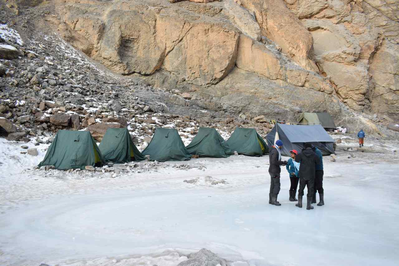 Tents pitched on a frozen river