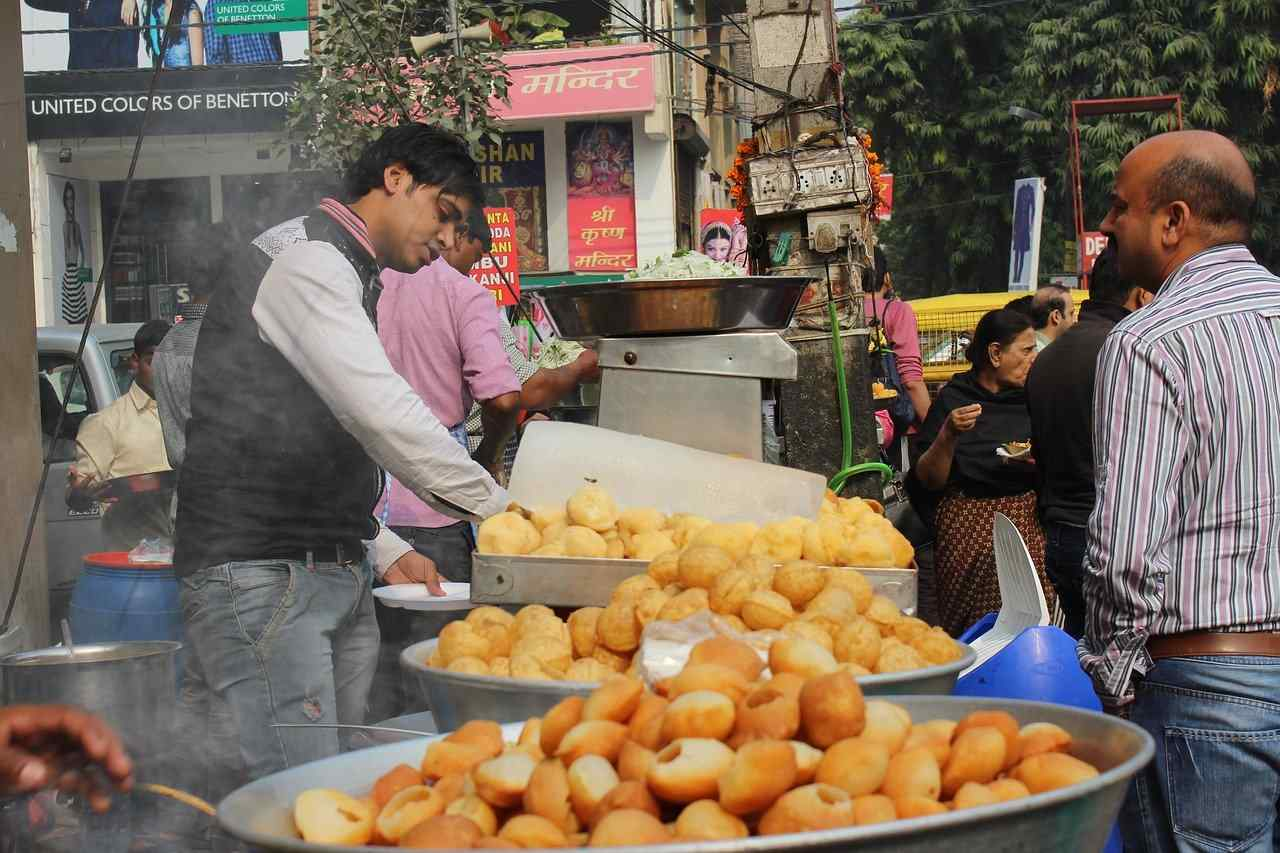 A person serving pani puri.