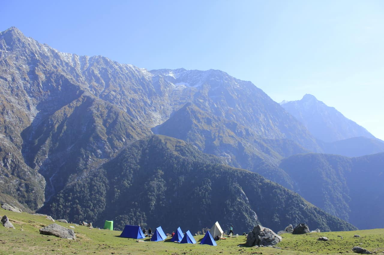 Campsite surrounded by tall mountains