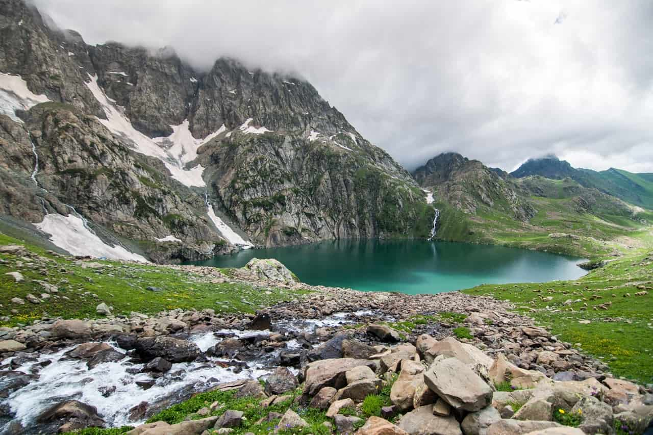 An azure lake surrounded by hills