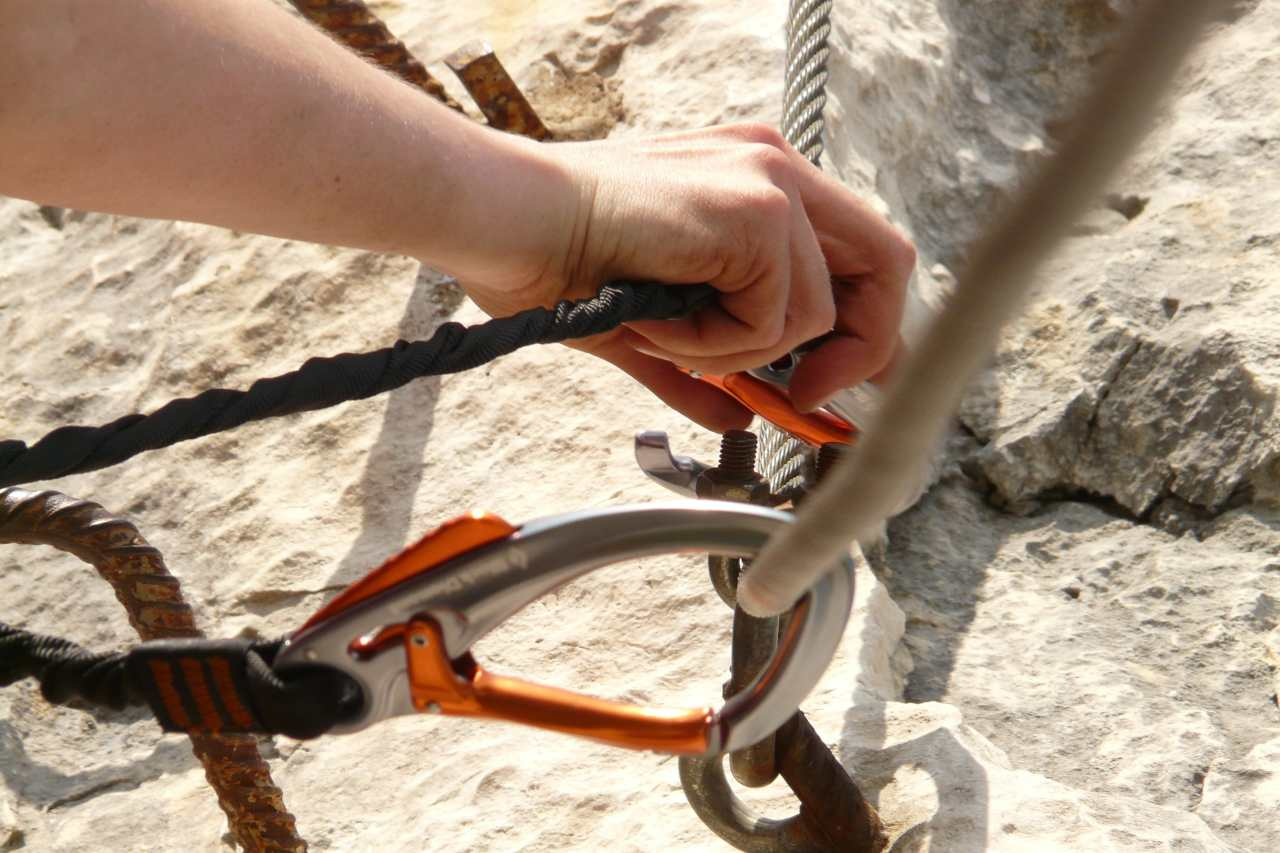 Setting up carabiners and ropes.