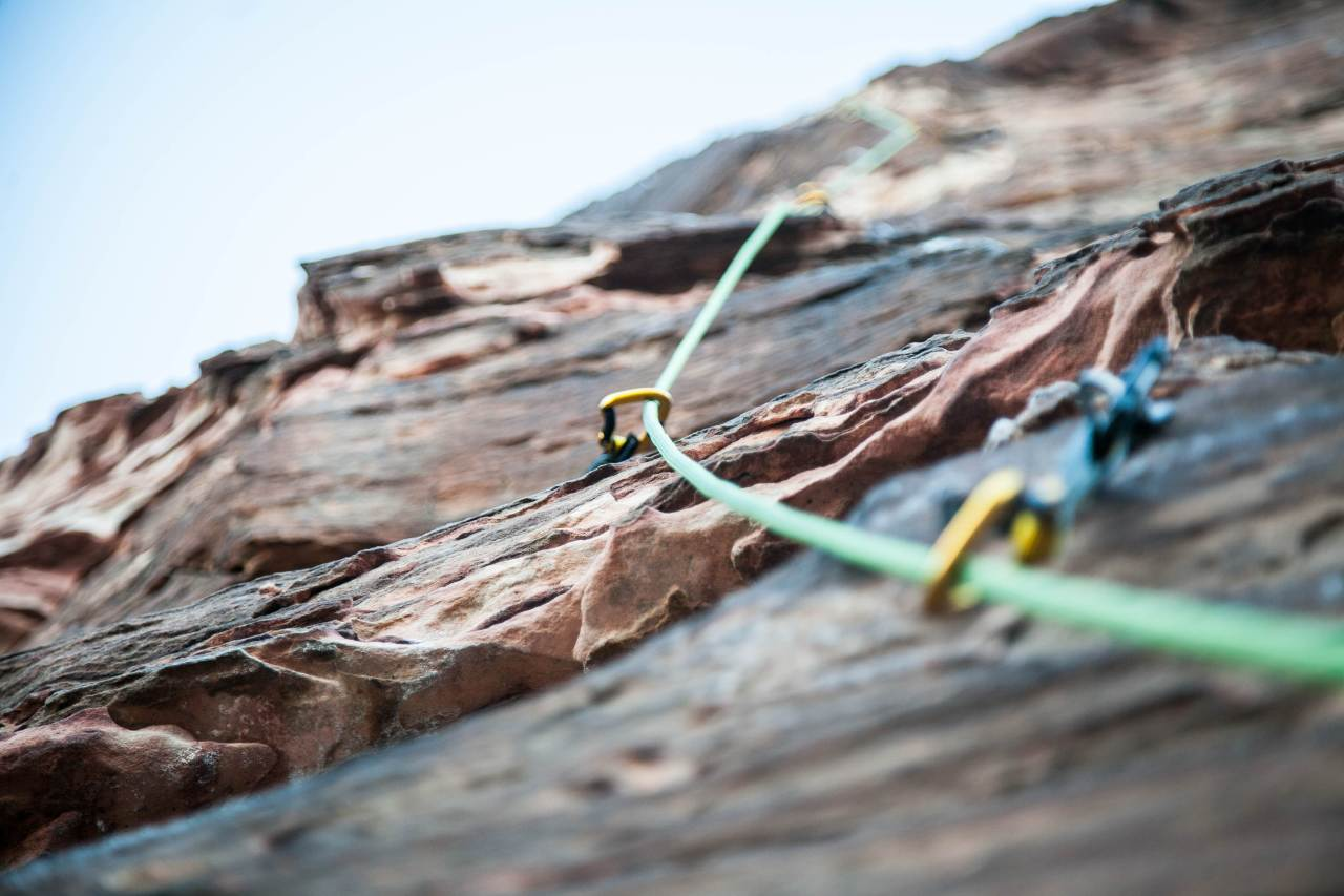 Carabiners and ropes set up for rock climbing