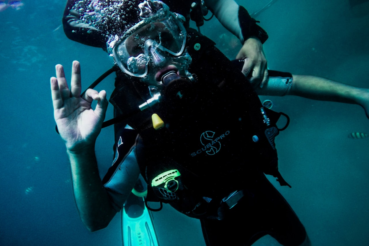 Scuba diver swims off into the distance